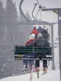 Couple Riding Up the Ski Lift During a Snow Storm, Vail, Colorado, USA Photographic Print by Paul Sutton