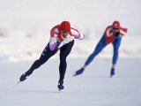Female Speed Skaters in Action Fotografie-Druck