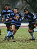 Rugby Players in Action, Paris, France Reproduction photographique par Paul Sutton