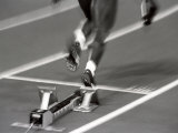 Detail of Woman Pushing Out of the Starting Blocks Photographic Print by Paul Sutton