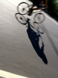 Cyclist and His Shadow Fotografisk tryk af Chris Trotman
