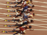 Blurred Action of Male Runners Starting a 100 Meter Sprint Race Photographic Print by Paul Sutton