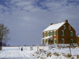 Huddled Figure Walks Up a Snow-Covered Road to an Amish Farmhouse Photographic Print by Howell Walker