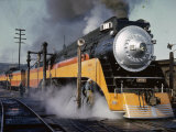 Man Fuels a Steam Locomotive at the Terminal Photographic Print by B. Anthony Stewart