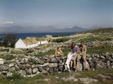 Teenagers Relax on a Stonewall Near their Home in Connemara Photographic Print by Howell Walker