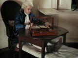Reenacter Uses Two of Thomas Jefferson's Inventions Reproduction photographique par Edwin L. Wisherd