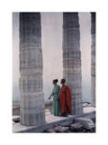 Two Dancers in Costume Stand Between Columns of Poseidon's Temple Photographic Print by Maynard Owen Williams
