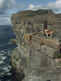 Irishman with His Dog Admire the View of the Ocean from a Cliff Photographic Print by Howell Walker