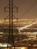 Denver Skyline Lights Up the Night, Framed by Power Lines Fotografisk trykk av Jim Richardson