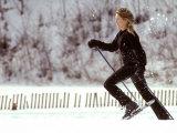 Woman Runs with Snowshoes Reproduction photographique par Skip Brown