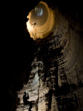 Cavers Rappelling the Entrance Drop of a 227-Foot-Deep Cave Pit Fotografie-Druck von Stephen Alvarez