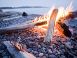 Campfire Burns on a Beach Photographic Print by Taylor S. Kennedy