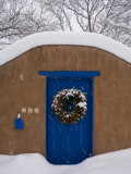 Snow Covered Christmas Wreath Adorns a Blue Door in Santa Fe Photographic Print by Ralph Lee Hopkins