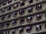 Laundry Drying Outside Apartments Window Where People are Cooling Off Fotografisk tryk af Paul Chesley