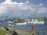 People at Gosport Hard Park Watch Ship Traffic at Naval Dockyards Photographic Print by B. Anthony Stewart