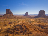 Monument Valley and the Three Mittens Rock Formations on a Clear Day Photographic Print by Mike Theiss