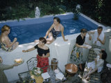 Men and Women Relax Beside a Small Backyard Swimming Pool Photographic Print by B. Anthony Stewart