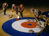 Women Sweep the Ice Ahead of a Curling Stone During a Curling Match Photographic Print by B. Anthony Stewart