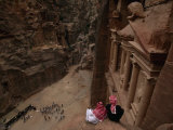 Two Bedouin Men Look Down Upon Tourists Admiring the Facade of Al Khazneh (The Treasury) Reproduction photographique par Annie Griffiths Belt