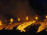 Molten Slag Cascades Down a Hillside at Night Photographic Print by B. Anthony Stewart