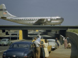 Sightseers Park to Watch a Stratocruiser Taxi across an Underpass Photographic Print by B. Anthony Stewart