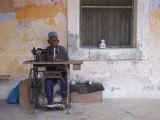 Man Works His Sewing Machine on Ibo Island, Part of the Quirimbas Archipelago, Mozambique Lámina fotográfica por Julian Love