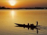 Mopti, at Sunset, a Boatman in a Pirogue Ferries Passengers across the Niger River to Mopti, Mali Fotografisk tryk af Nigel Pavitt