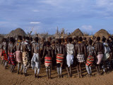 Men Hold Hands Forming a Circle Within Which the Women Dance in the Karo Village of Duss,Ethiopia Lámina fotográfica por John Warburton-lee