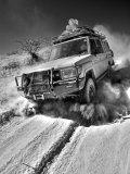Damaraland, Four Wheel Drive Vehicles are the Best Means of Travel in Desert Environment, Namibia Fotoprint av Mark Hannaford