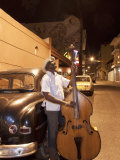Bass Player, Santiago De Cuba, Cuba, West Indies, Central America Fotoprint van Angelo Cavalli