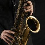 Male Hands Playing Saxophone Premium fotoprint van Alfonse Pagano