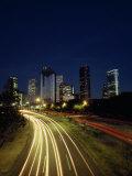 Headlights and Taillights on a Highway and Houston at Night Fotografisk trykk av Lynn Johnson