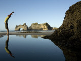Man Stretches His Back Yoga Style on the Beach Photographic Print by Dawn Kish