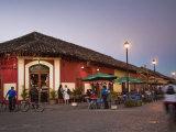 Man Rideing Bike Past Restaurant on Calle La Calzada, Granada, Nicaragua, Central America Fotoprint av Jane Sweeney