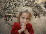 Afghan Refugee Child Looks on in a Neighborhood of Rawalpindi, Pakistan Reproduction photographique