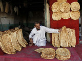 Baker Arranges Breads at His Shop in Kandahar Province, South of Kabul, Afghanistan Valokuvavedos