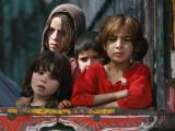 Children from Swat Arrive on a Truck at a Refugee Camp in Mardan, Northwest Pakistan Impressão fotográfica
