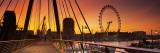 Golden Jubilee Bridge across a Thames River, Ferris Wheel in Back, London, England Photographic Print
