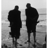 Two Men Paddling in the Sea: They Wear Formal Suits Photographic Print by Henry Grant