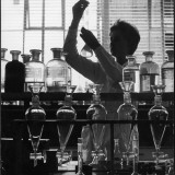 A Chemist at Work in Her Laboratory Photographic Print by Henry Grant