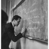 A Teacher Writing on a Blackboard at Northfield House Junior School, Leicester Photographic Print by Henry Grant
