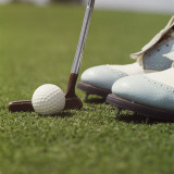 Close Up of Golf Ball , Putter and Shoes on Grass Photographic Print by Dennis Hallinan