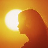 Silhouette of Woman in Profile at Sunset Photographic Print by Dennis Hallinan
