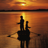 Silhouette of Father and Son Fishing at Sunset Photographic Print by Dennis Hallinan