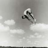 Man Jumping Off Diving Board Photographic Print by Dennis Hallinan