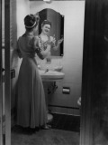 Young Woman Brushing Teeth in Bathroom Photographic Print by George Marks