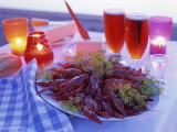 A Plate Full of Crayfish, Glasses with Beer and Lit Candles Fotografisk tryk