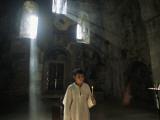 An Altar Boy Holds a Candle Inside a Dimly-Lit Church Photographic Print by Randy Olson