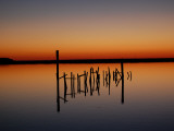 Sunset over Calm Water and a Dilapidated Old Pier Photographic Print by Ross Kelly