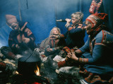 A Lapp Family Prepares a Meal in their Tent Impressão fotográfica por George F. Mobley